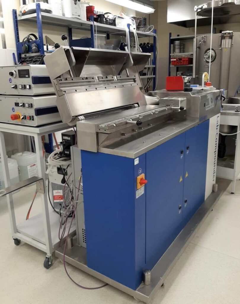 2-screw extruder in a research facility.